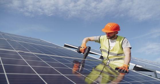 https://www.pexels.com/photo/man-fixing-solar-panels-with-professional-drill-4254165/